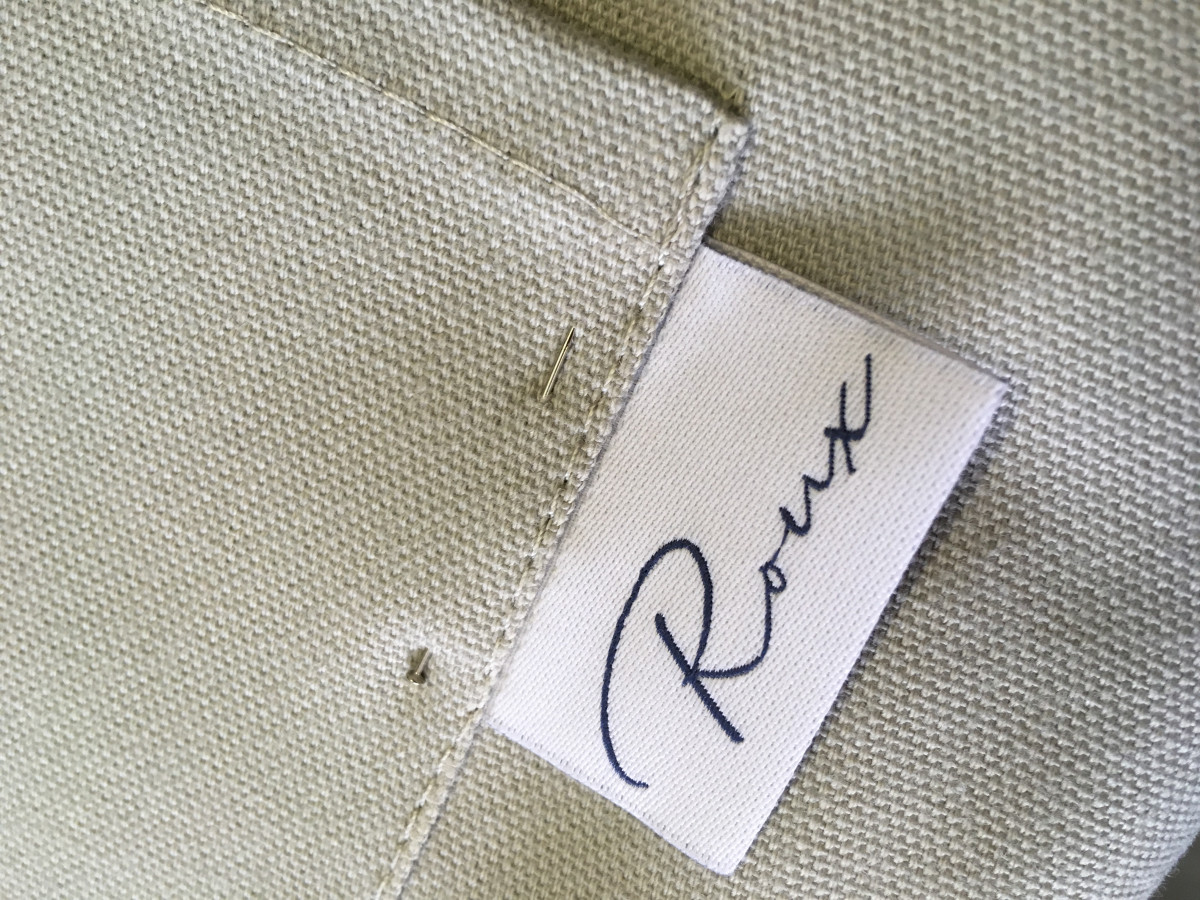 Made to order bespoke tabs and labels on apron pockets